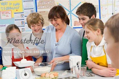 Schoolchildren and teacher at school in a cooking class