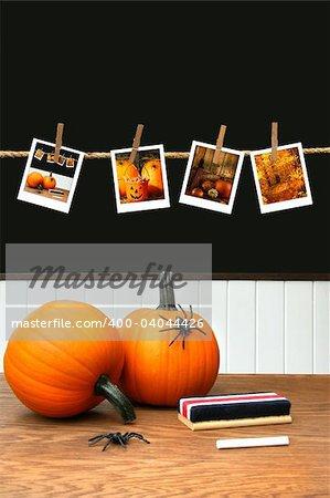 Pumpkins on school desk  in classroom for decorations