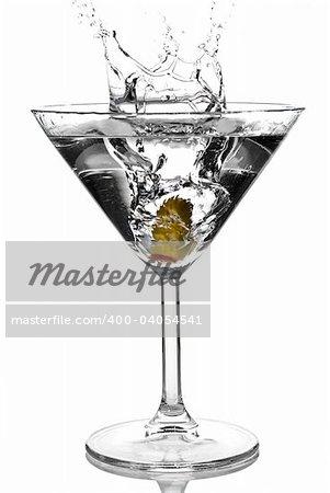 Olive splashing on martini isolated on white stock photo