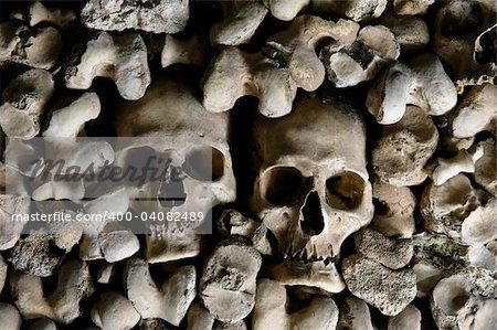 Human skulls covering the walls of the Bones Chapel, Evora, Portugal