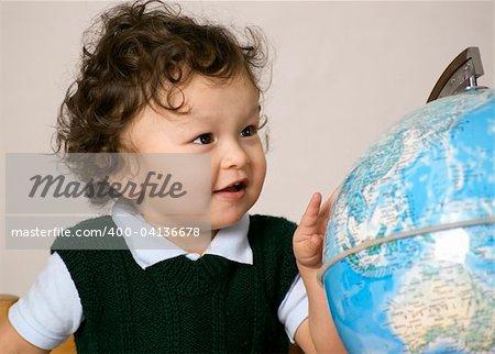 Cheerful child with globe.
