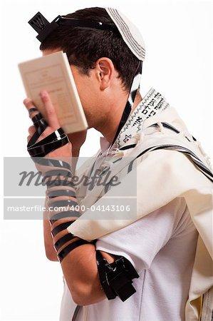 jewish men praying on isolated background