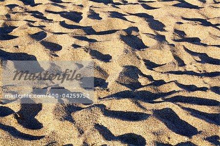 Waves of beach sand. Summer background.