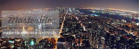 New York City aerial view panorama with Manhattan skyline at night.