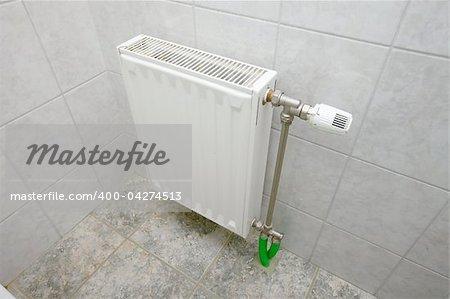 Heating radiator in a bathroom