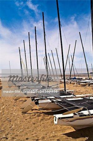 many yachts on sand, beach