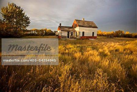 Abandoned Farmhouse at sunset Saskatchewan Canada
