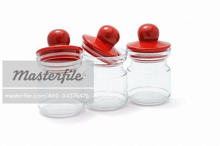 Three small empty plastic jars isolated on white
