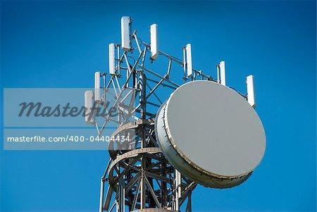 Cellphone antenna tower against a blue sky