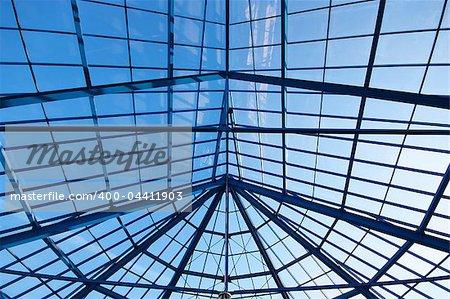 Blue sky through glass roof of modern biulding