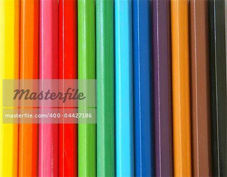 Wooden colour pencils close-up background.