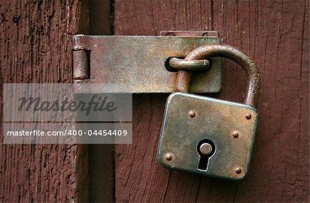 Close-up of an old rusty padlock