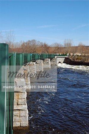 Winter rains keep the Blackstone River flowing beneath the bikeway in Lincoln, RI, USA