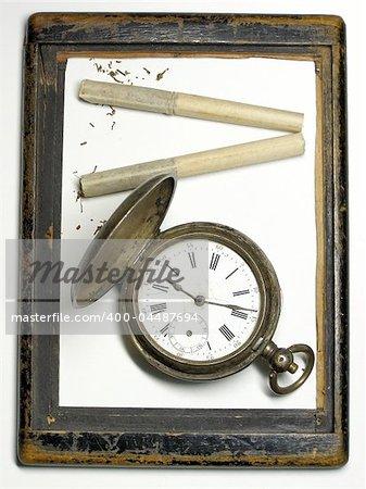 vintage silver clock, old cigarette in the retro frame