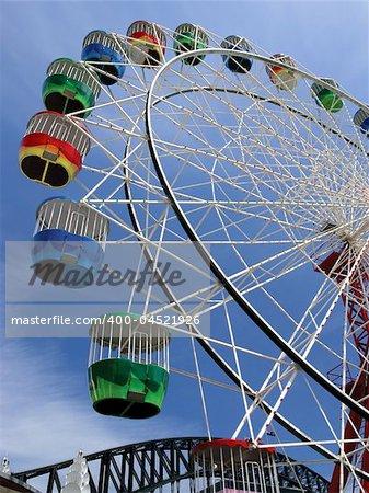 Colourful ferris wheel in Australia.  Slight movement visible.