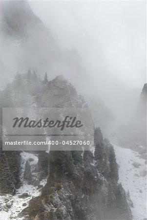 Rocks, forest and fog Kazakhstan, TyanShan mountains, Small Almaty gorge