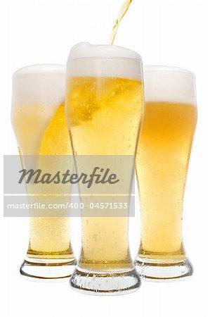 Three beers served in pilsner glasses