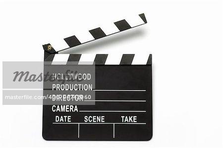 Movie clapper board over white