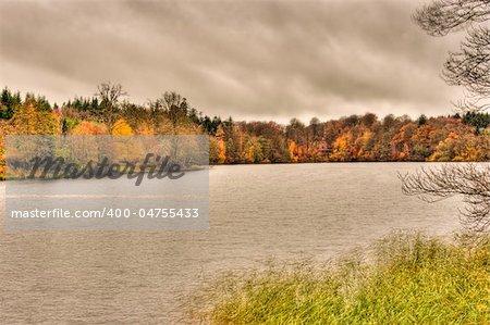 view of far lake shore in autumn