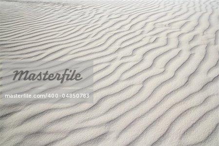 Caribbean sand waves desert pattern background beige