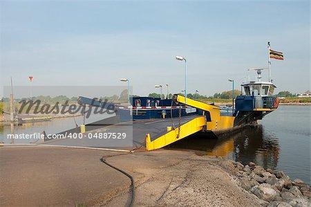 small ferryboat crossing the IJssel river in Netherlands