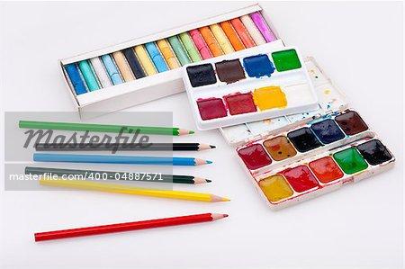 School supplies. Watercolor, pencil and pastel colors