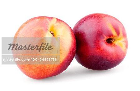 Two ripe nectarines isolated on white background