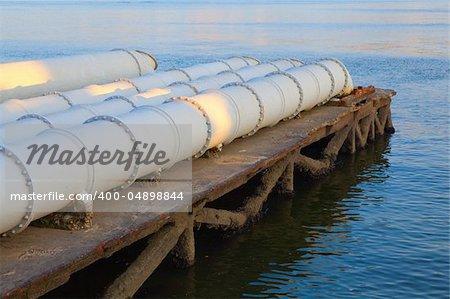 A closeup of large sewage pipes