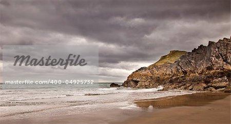 Beach and sea with brooding sky