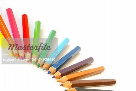 Wooden colour pencils close-up composition.