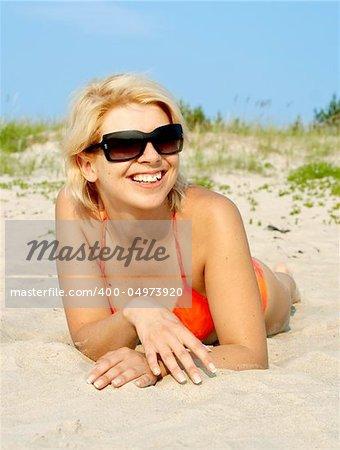 happy girl in orange bikini