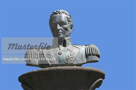 Simon Bolivar sculpture against blue sky