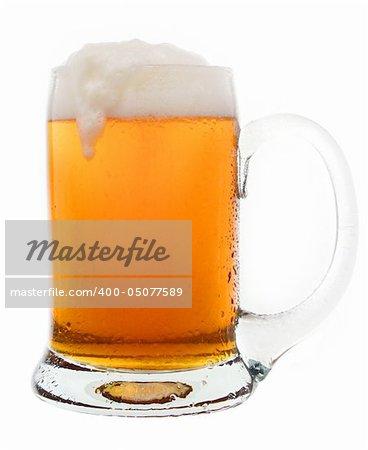 Cold tasty beer in a glass mug