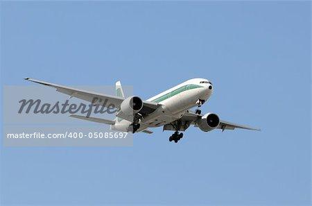Modern passenger jet airplane arriving at destination