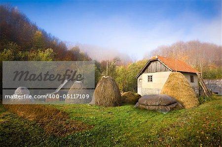 Farm house, haystacks, autumn colours