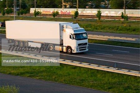 Freight white truck on motorway