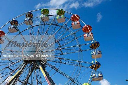 A colorful big fun wheel against blue sky