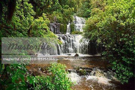 Cascading waterfall on the Purakaunui River in the South Island of New Zealand