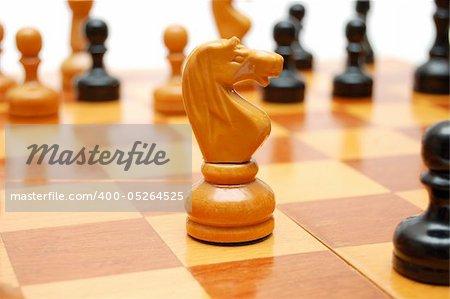 Knight chessman on chess board
