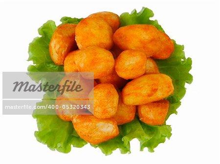 Hot roasted potatoes on salad