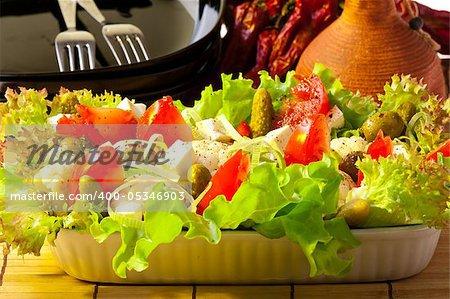 Greek salad in the white plate closeup shot