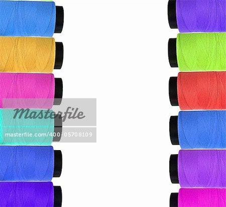 Many multicolor bobbins isolated on white background