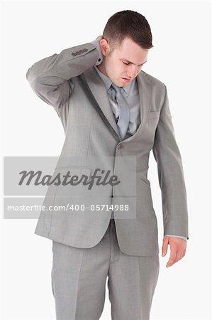 Portrait of a businessman having a neck pain against a white background