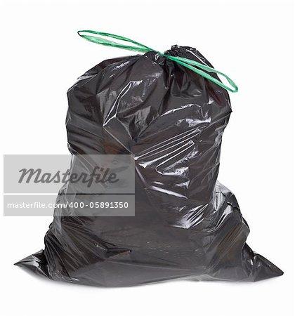 tied garbage bag on white background