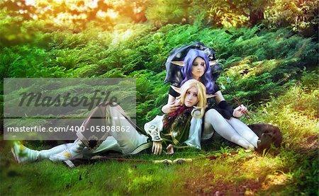 Elf boy and elf girl stayng near the tree