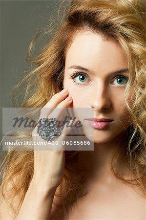 Beautiful Young Woman Face. Close-up studio portrait.
