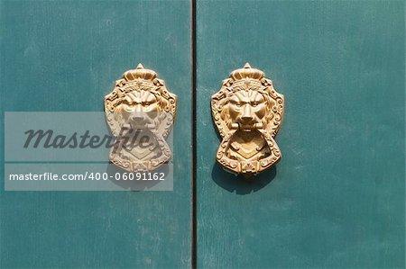 Old medieval bronze door knocker lion head