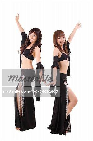 Duet belly dancer posing on white