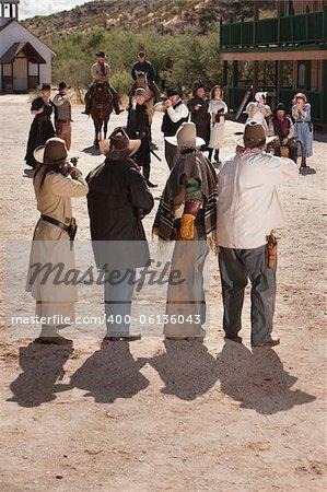 Dangerous gunfight outside in old American west scene