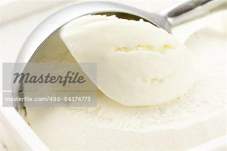 creamy vanilla ice cream in a white cup